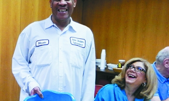 Marvin Brown takes his cooking seriously at Adat Shalom, where he serves a morning minyan meal.