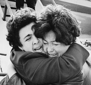Soviet Jewish sisters are overwhelmed by emotion at the airport as they begin their new life in Detroit.