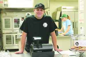 Eric Hughey, deli manager and MSU Hillel director of special projects, on opening day