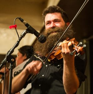 Aaron Jonah Lewis of Detroit plays the fiddle