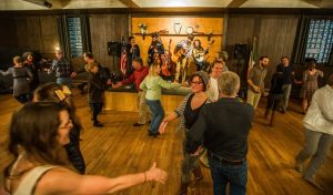 People dance as the Detroit Square Dance Society Band plays.