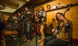 Members of the Square Dance Society Band: Lindsay McCaw, caller; Aaron Jonah Lewis, fiddle; Rachel Pearson, stand-up bass; Erik Alan, guitar; and Hannah Lewis, banjo.
