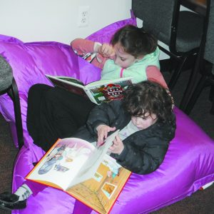 Children relax with some books.